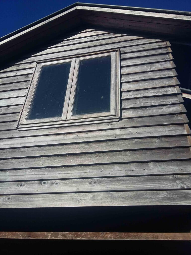 picture of walls which shows cedar cladding before the wash process.